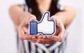 Facebook like button johor malaysia july this icon is the voting system used to rate user comments on low shu ching hand holding Royalty Free Stock Photos