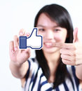 Facebook like button johor malaysia july this icon is the voting system used to rate user comments on low shu ching hand holding Royalty Free Stock Images