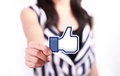 Facebook like button johor malaysia july this icon is the voting system used to rate user comments on low shu ching hand holding Stock Photography
