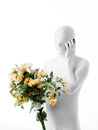 Faceless man with rose bouquet dressed white a of roses in hand talking on the phone Royalty Free Stock Photos