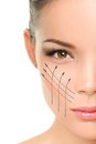 Facelift anti aging treatment on woman face skin lift asian portrait with graphic lines showing facial lifting effect perfect Stock Photography