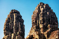Faces of ancient Bayon Temple At Angkor Wat Stock Images