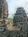 Faces of bayon temple siem reap one the many smiling buddha at in cambodia Royalty Free Stock Image