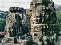 Faces on the bayon temple towers is a richly decorated khmer at angkor in cambodia built in late th or early th century it stands Royalty Free Stock Images