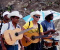 Faces of cuba musicians on beach at playa del este walking the Royalty Free Stock Photos