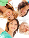 Faces of girls looking down and smiling summer holidays vacation concept Royalty Free Stock Image