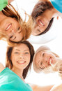 Faces of girls looking down and smiling summer holidays vacation concept Stock Images