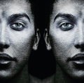Faces of male twins with textured skin Stock Photography