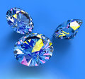 Faceted blue diamonds blue background Royalty Free Stock Photography