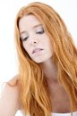 Facial portrait of troubled redhead natural beauty with long red hair Stock Image
