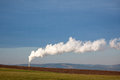 Factory chimney polluting the air in clean landscape Stock Image