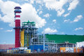 Factory with colorful tower and metallic tubes plant on sky background Royalty Free Stock Photography