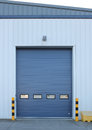 Factory loading bay roller door on industrial building Royalty Free Stock Photo
