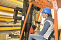 Factory operator using storage vehicle Royalty Free Stock Photo