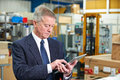 Factory Owner Using Digital Tablet Royalty Free Stock Photo