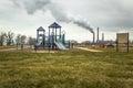 Factory Smokestack Behind Playground Royalty Free Stock Photo