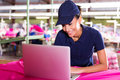 Factory worker laptop happy female using Royalty Free Stock Image