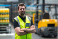 Factory worker standing with arms crossed in factory Royalty Free Stock Photo