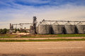 Factory yard metal tank of modern silo in countryside Royalty Free Stock Photo