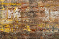Faded advertisement on a brick wall faint remnant of an old the of an old building Royalty Free Stock Photography