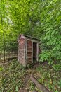 Faded Red Outhouse Royalty Free Stock Photo