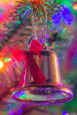 Faded silver bell christmas ornament plastic tree Stock Images