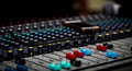 fader digital mixing console with volume meter Royalty Free Stock Photo