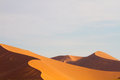 Fading light the casts deep shadows across the sand dunes of sossusvlei namibia Stock Photography