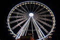 A fair ground big wheel huge all light up as it turns around at the winter wonder land in hyde park london at christmas time Stock Photography