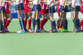 Fair play concept for sportsmanship showing two oppsing teams of women field hockey players shaking hands after the line up of an Royalty Free Stock Photo