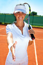 Fair player smiling female tennis giving hand for handshake Royalty Free Stock Photography