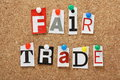 Fair trade the phrase in cut out magazine letters pinned to a cork notice board Royalty Free Stock Image