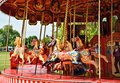 Fairground carousel of brilliantly painted horses Royalty Free Stock Photography