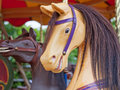 Fairground horses rides on a traditional english carousel Royalty Free Stock Images