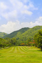 Fairway of a golf course beside the mountain Royalty Free Stock Photo