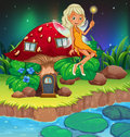 A fairy above the red mushroom house illustration of Stock Images