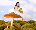 Fairy child on a toadstool Royalty Free Stock Photo