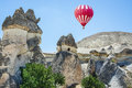 Fairy Chimneys in Cappadocia and hot air balloon Royalty Free Stock Photo