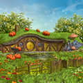 Fairy cottage with pumpkins mushrooms and flowers on a meadow Stock Images