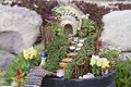 Fairy garden in a flower pot outdoors Royalty Free Stock Photo
