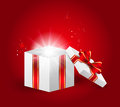 Fairy gift box with light on red background Royalty Free Stock Photos