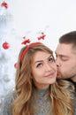 Fairy kiss near Christmas tree Royalty Free Stock Photo