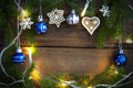 Fairy lights and christmas decoration as background on wood different decorations or winter with copy space Royalty Free Stock Photos