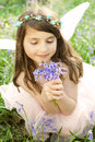 Fairy princess in bluebells a sea of deep the woods floral headdress and backlit by sunlight Royalty Free Stock Photos