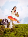 Fairy tale girl on toadstool Stock Photos