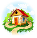 Fairy-tale house among trees with walk path Royalty Free Stock Image