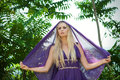 Fairy-tale - portrait of woman in purple with veil Royalty Free Stock Photo