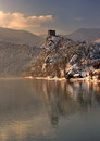 Fairy tale winter castle and its mirror image on the surface of river, Strecno, Slovakia
