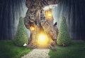 Fairy tree house in dark fantasy forest Royalty Free Stock Photo