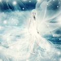 Fairy woman on snow winter background frozen in white wind dress and blue Stock Images